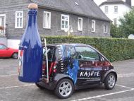 Smart mit Sektflasche